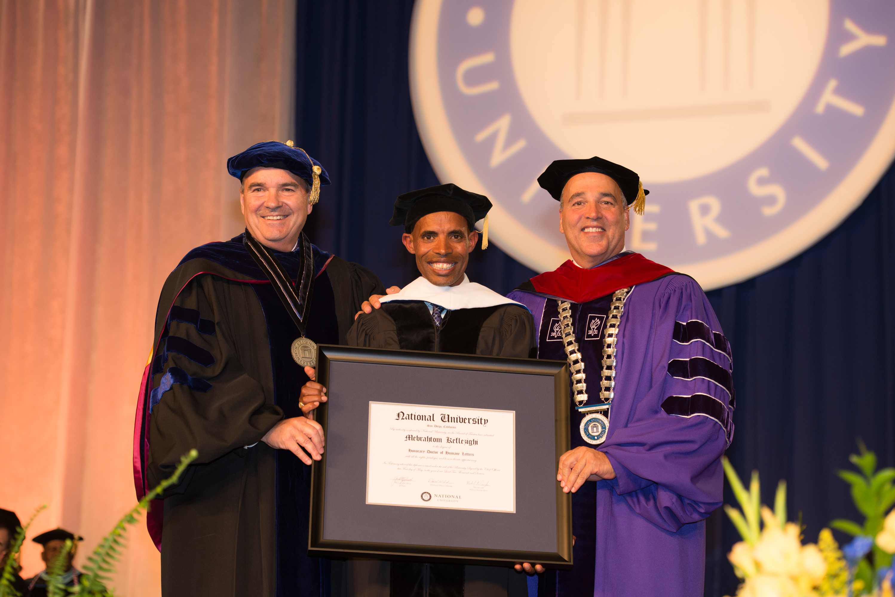 Meb Keflezighi with an honorary doctorate degree